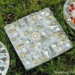 Mosaic stepping stones are a perfect summer craft. Gather flea market finds like keys and coins, then embed them in concrete. Great craft with kids!