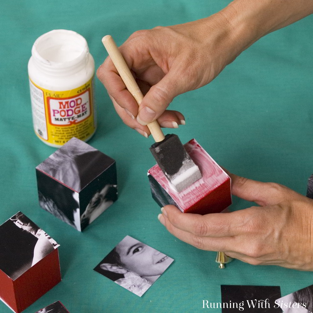 Turn six favorite photos into infinite fun! Simply cut pictures into squares and mount them onto wooden cubes with ModPodge to make Photo Blocks!