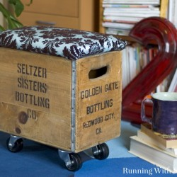 Make a funky DIY storage ottoman from a flea market crate! Casters make it cool and moveable and padding on top makes it comfy!
