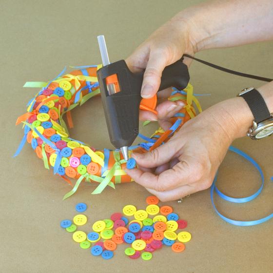 Cute-As-A-Button Wreath Step 5 Glue On Buttons