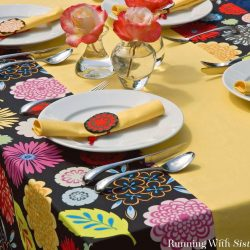 Learn to sew a tablecloth with a built in runner. We'll show you how to sew the pieces together, hem the edges, and create tidy corners.