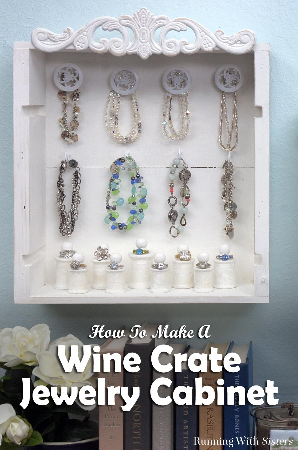 Make a wine crate jewelry cabinet with wine crates, wooden spools, and cabinet knobs. You can get wine crates from wine shops and they're usually free!