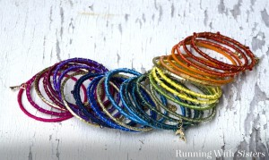 Make a stack of ribbon wrapped bracelets. Just wrap wire bangles with colorful ribbons and wire, then add charms. Complete how-to plus video!