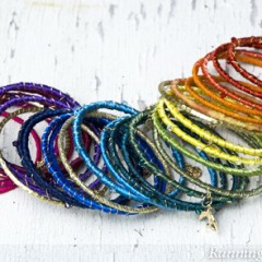 These Boho Bangles look like they came from a boutique, but they are so easy to make with inexpensive metal bracelets, colorful ribbon, and lots of charms!
