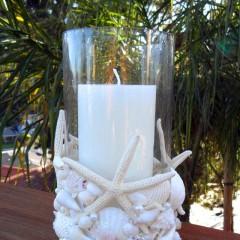 Seashell Candleholder Make a beachy seashell candleholder by adding real shells and starfish to a glass hurricane.