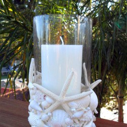 Make a Pottery barn knock-off seashell candleholder with seashells, pearls, and iridescent glitter for an elegant finish!