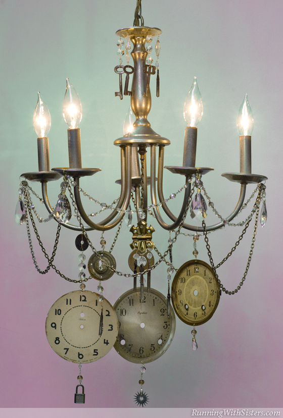 steampunk clockface chandelier running with sisters