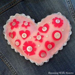 Make a sweet heart pillow from felt and buttons! This kid craft is easy and fun to make for Valentine's Day!