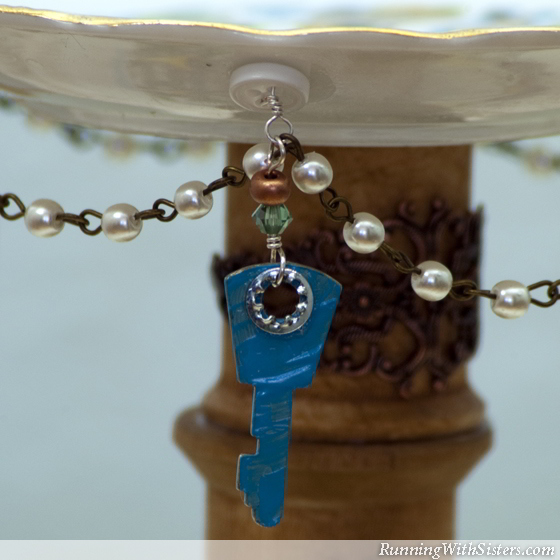 Make a tiered jewelry display with flea market finds like china plates and wooden spools. Then add a little Steampunk Chic flair with tiny locks and keys!