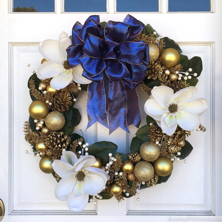 Make a magnolia and glittered pinecone holiday wreath for Christmas. We'll show you how to layer the decorations and how to make a big, loopy bow!