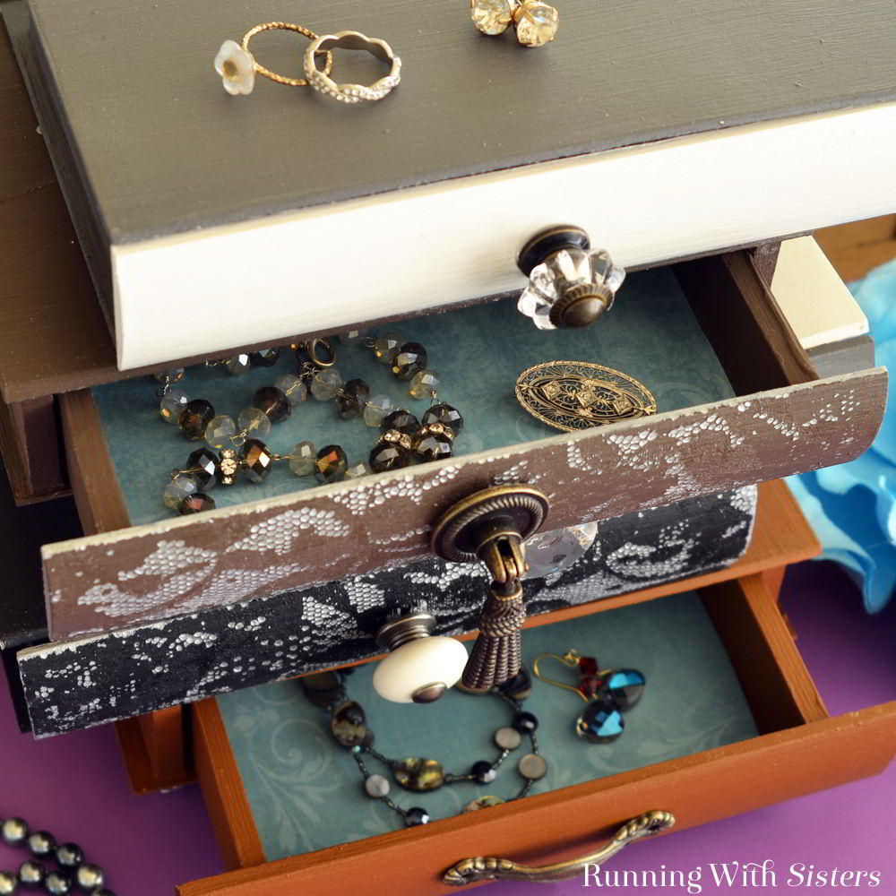 Make a Whimsical Jewelry Box inspired by Anthropologie! We'll show you how to stencil through lace and drill the drawers to add vintage knobs!