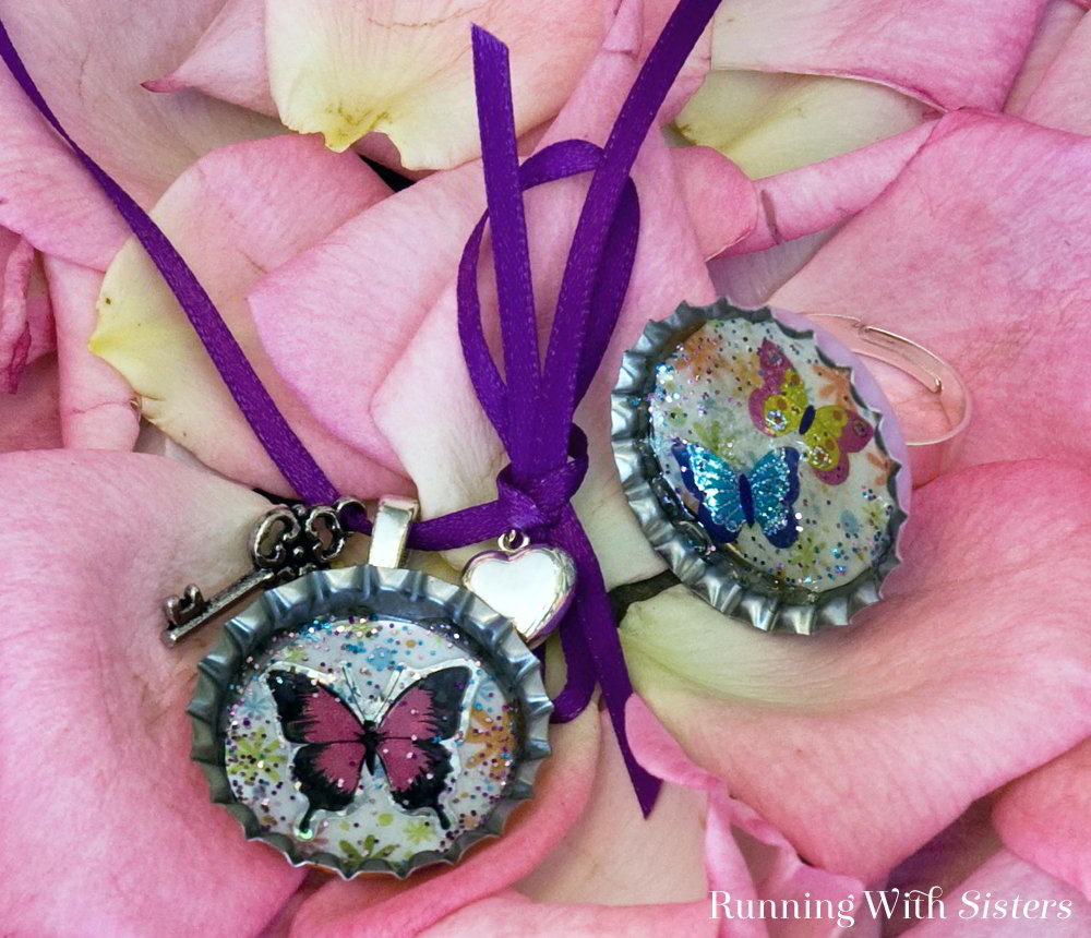 Make your own sparkling Butterfly Bottle Cap Ring and Necklace! Make a pendant and a ring using butterfly stickers, glitter, and Mod Podge Dimensional Magic.