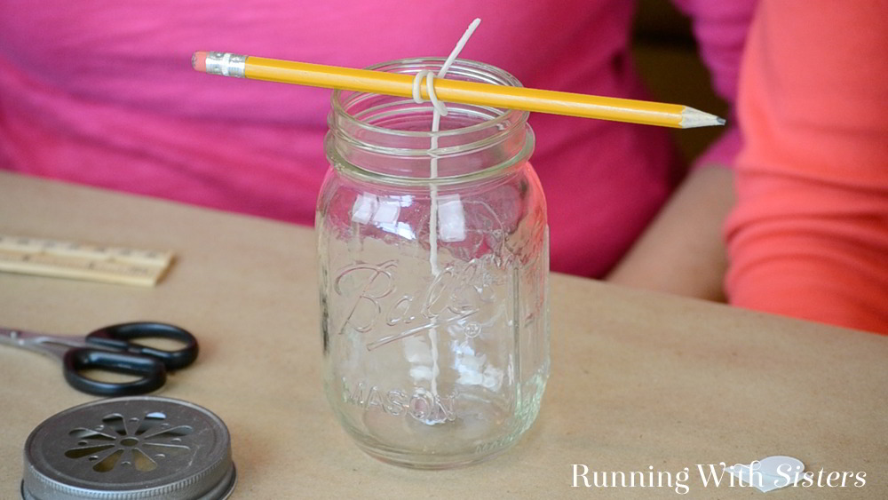This handmade Citronella Mason Jar Candle is perfect for use outdoors. We'll show you how to wick a jar to make your own citronella candle.