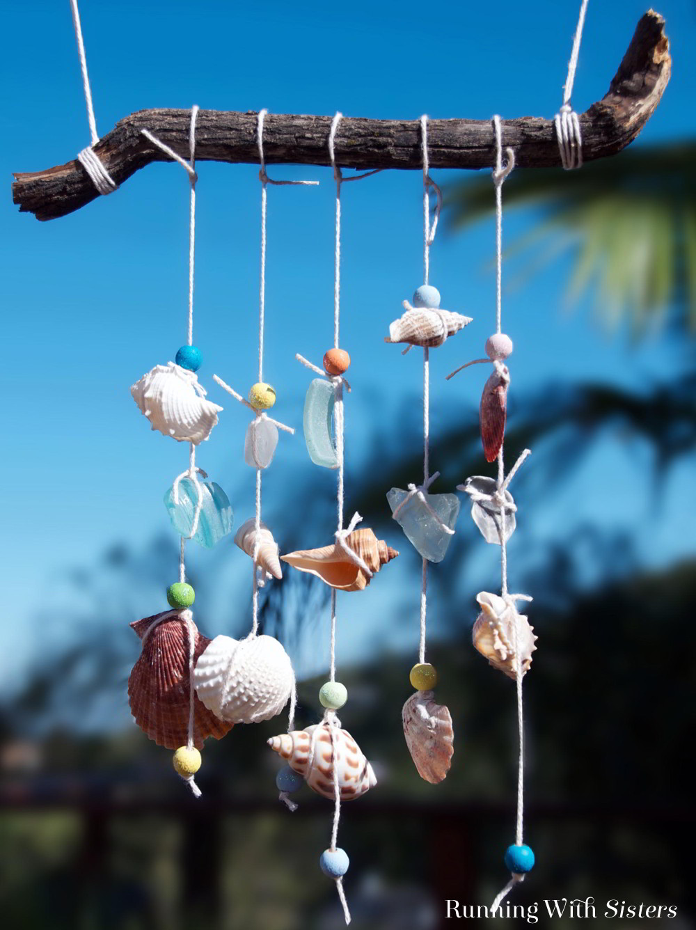 Make a seashell mobile as a souvenir of your summer trip to the beach. Collect seashells then string them with painted beads and sea glass. So pretty!
