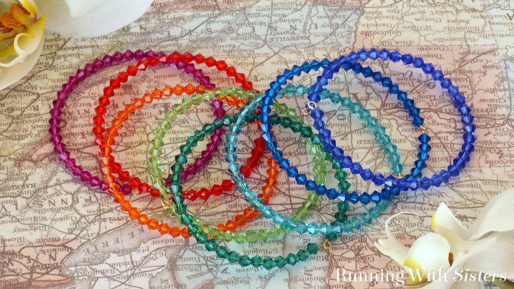 Make a rainbow of beaded bangle bracelets using memory wire. Memory wire is fast and easy. Just slide on the crystals! We'll show you how with a video!