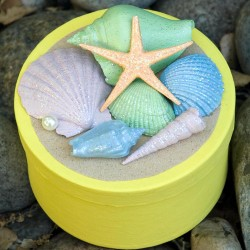 Make a beachy Starfish Treasure Box with glittery shells from the sea. Go for a beach walk and gather your shells, then paint them and glitter them to top off a little treasure box. Fill your Starfish Treasure Box with more treasures from your summer!