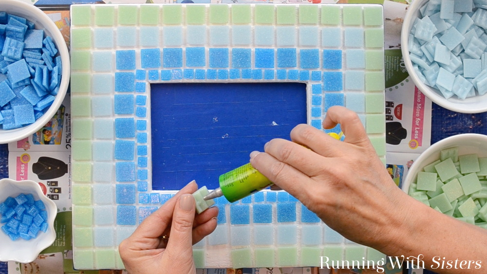 Learn to make a mosaic picture frame with glass mosaic tiles. We'll show you how to arrange the tiles and how to grout the mosaic picture frame.