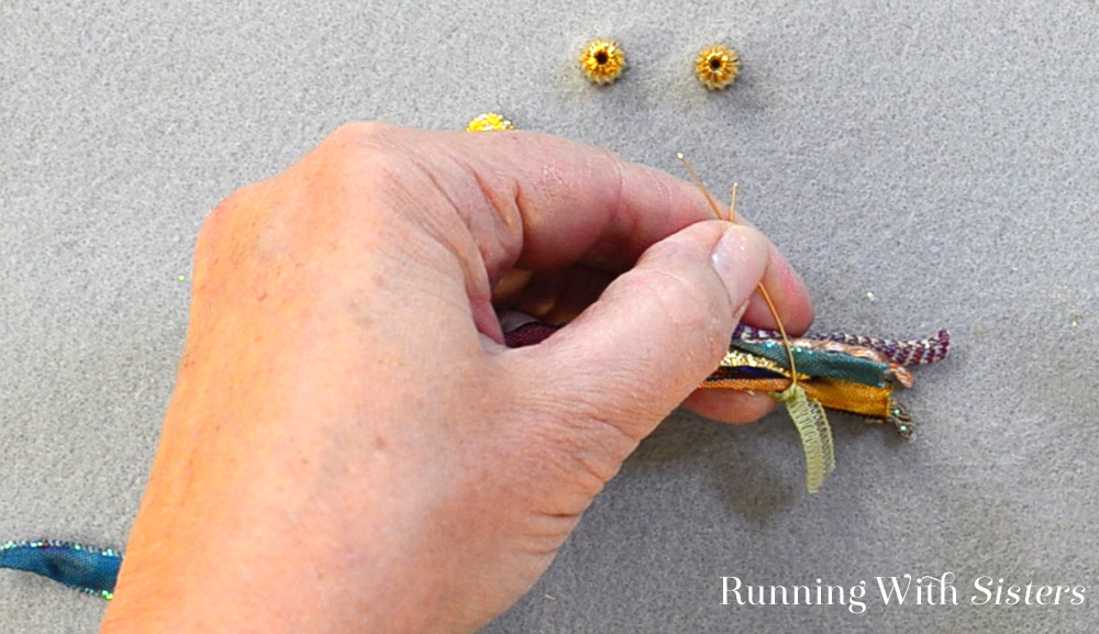 Make an elegant pandora ribbon bracelet using ribbon scraps and a pandora bead. Watch our video tutorial then follow the steps to diy your own!