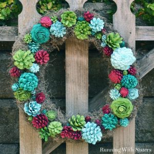 Make a faux succulent wreath from pine cones! Paint pine cones to look like succulents then arrange on a grapevine wreath!