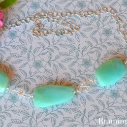 Make a beautiful gemstone necklace! In this jewelry tutorial, we'll show you how to do wirework to make this Peruvian Opal statement necklace.