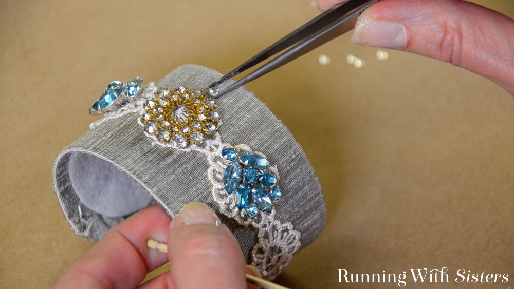 Make a vintage brooch bracelet. We'll show you how to cover a brass cuff with silk, then add lace and a vintage brooch and earrings.