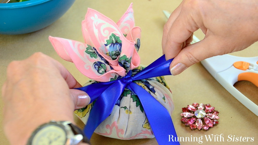Make a handmade gift with a vintage handkerchief! This Vintage Hankie Sachet is easy to make and so pretty! We'll show you how with a video tutorial.