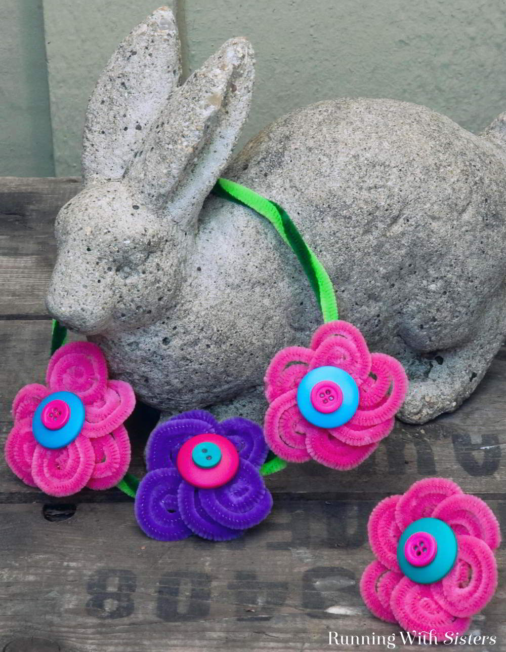 Learn to make pipe cleaner flowers to make your own Button Blossom Ring and Necklace! These chenille stem flowers are a great kid craft!