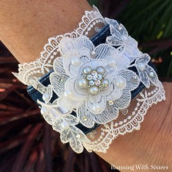 Upcycle an old pair of jeans into a Lace and Denim Cuff Bracelet. Just add lace trim, a pearl button, and a Velcro snap. We'll show you how!