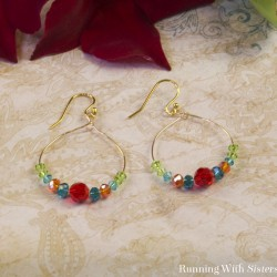 Learn to make a pretty pair of Dangling Crystal Hoop Earrings. We'll show you how to bend the wire into a hoop and attach it to the earring wires.