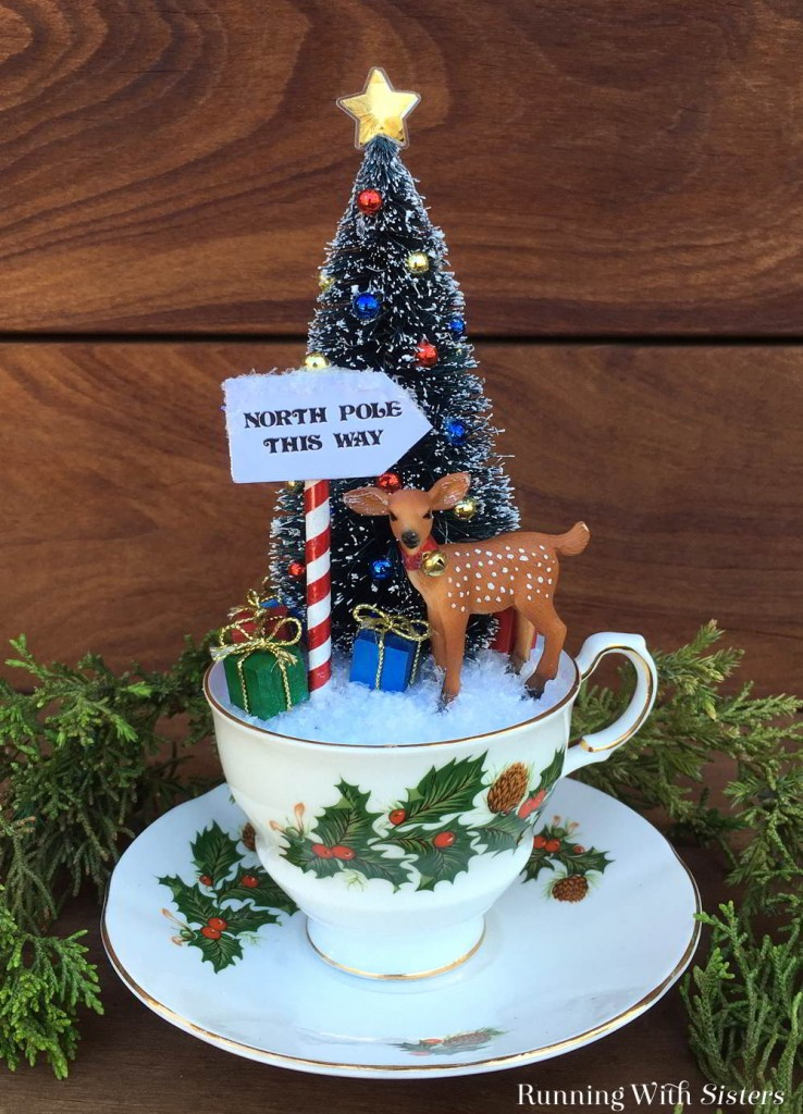 Make Teacup Christmas Scene with a bottlebrush tree and little reindeer. We'll show you how to make the North Pole sign and put it all together.