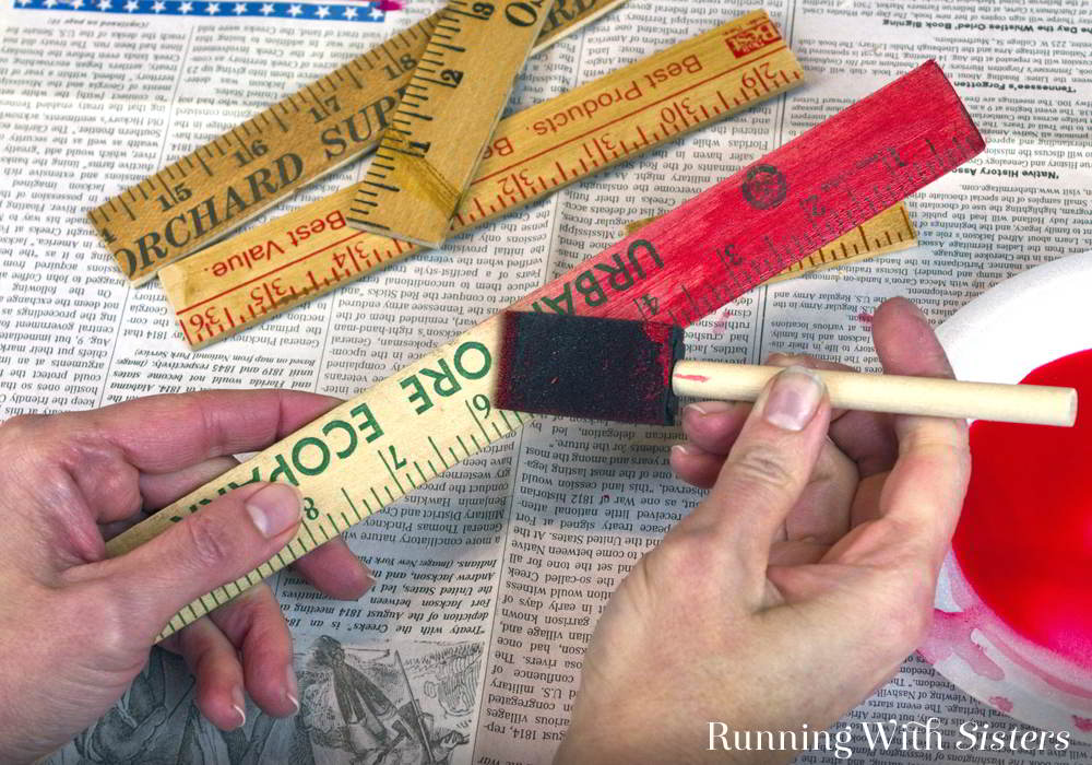 Make your own Vintage Yardstick Christmas Tree from rulers and yardsticks. Just cut the yardsticks to make the tree and add brooches as ornaments.