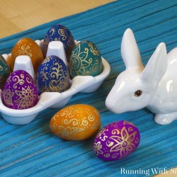 Make your own Boho Dyed Easter Eggs with wooden eggs and Ultra dye. Then draw on them Henna-style with a gold paint pen. Complete step-by-step instructions!