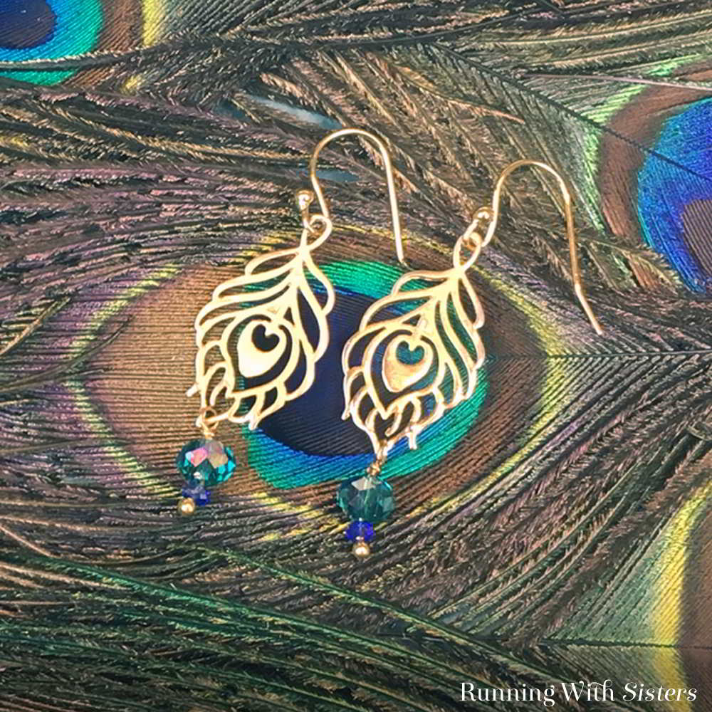 Learn to make Peacock Earrings. In this step by step tutorial with video we'll show you how to make the beaded dangles with wrapped loops.