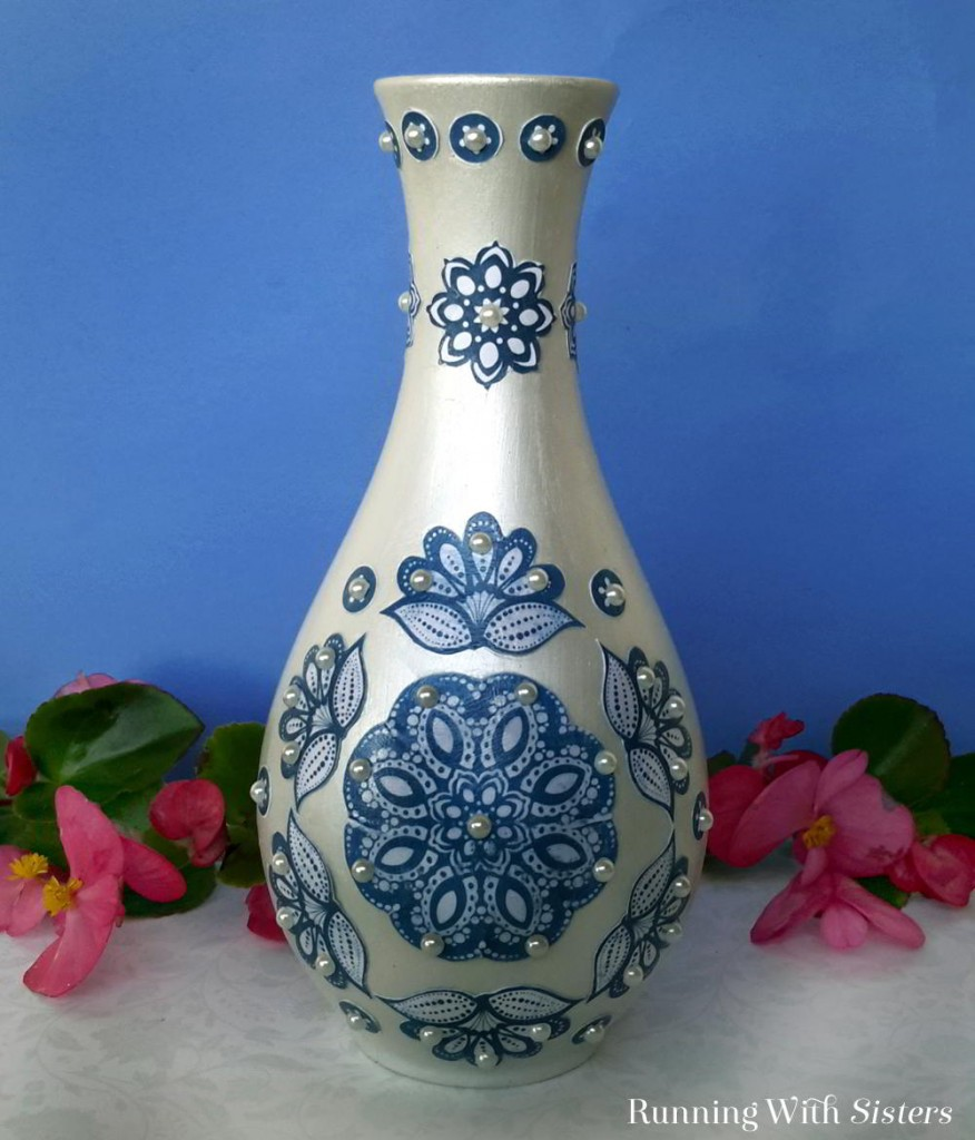 Turn a dollar store vase into a decorator show piece with Mod Podge and scrapbook paper!