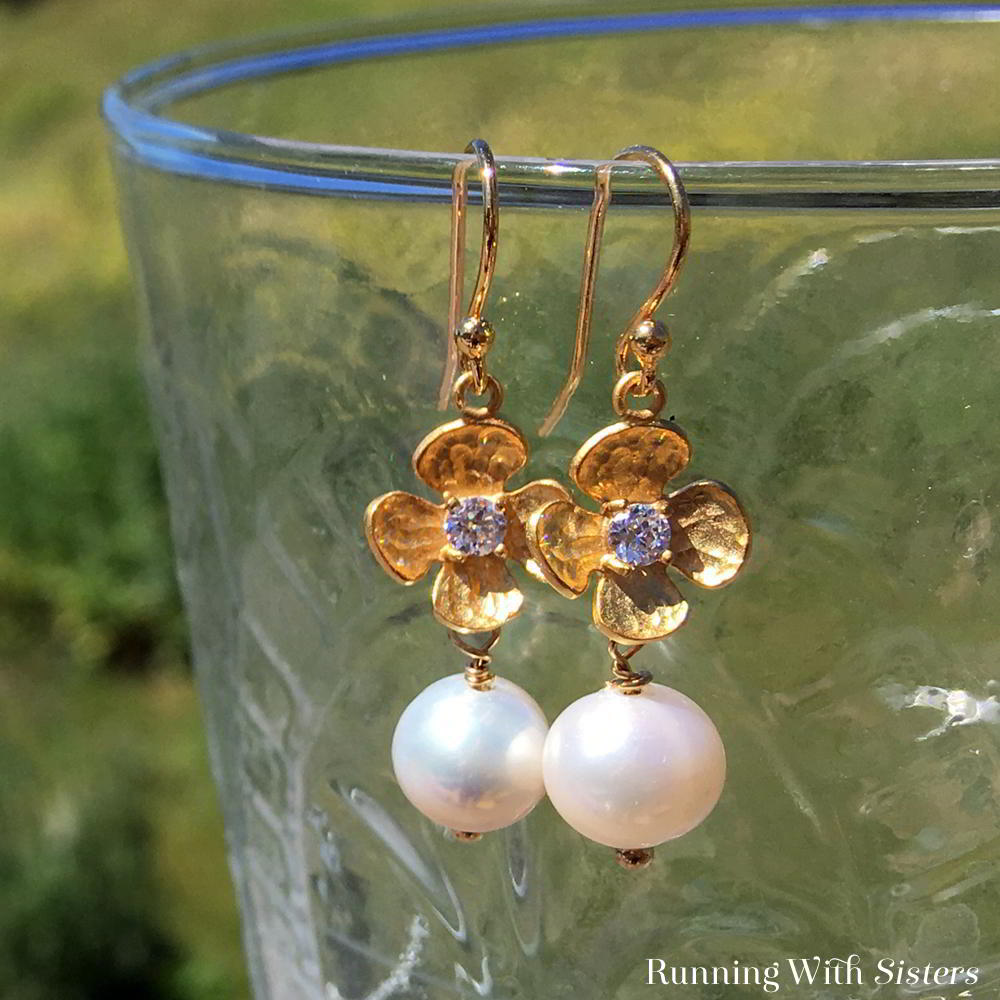 Make flower and pearl earrings for Mother's Day. These handmade earrings take just minutes to make! We'll show you how with this video jewelry tutorial.