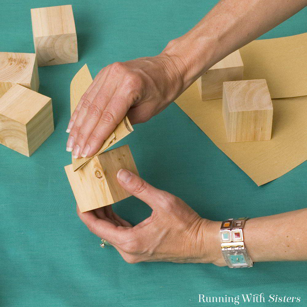 Make DIY photo blocks using Mod Podge and wooden cubes. It's like an interactive scrapbook. A great gift craft!