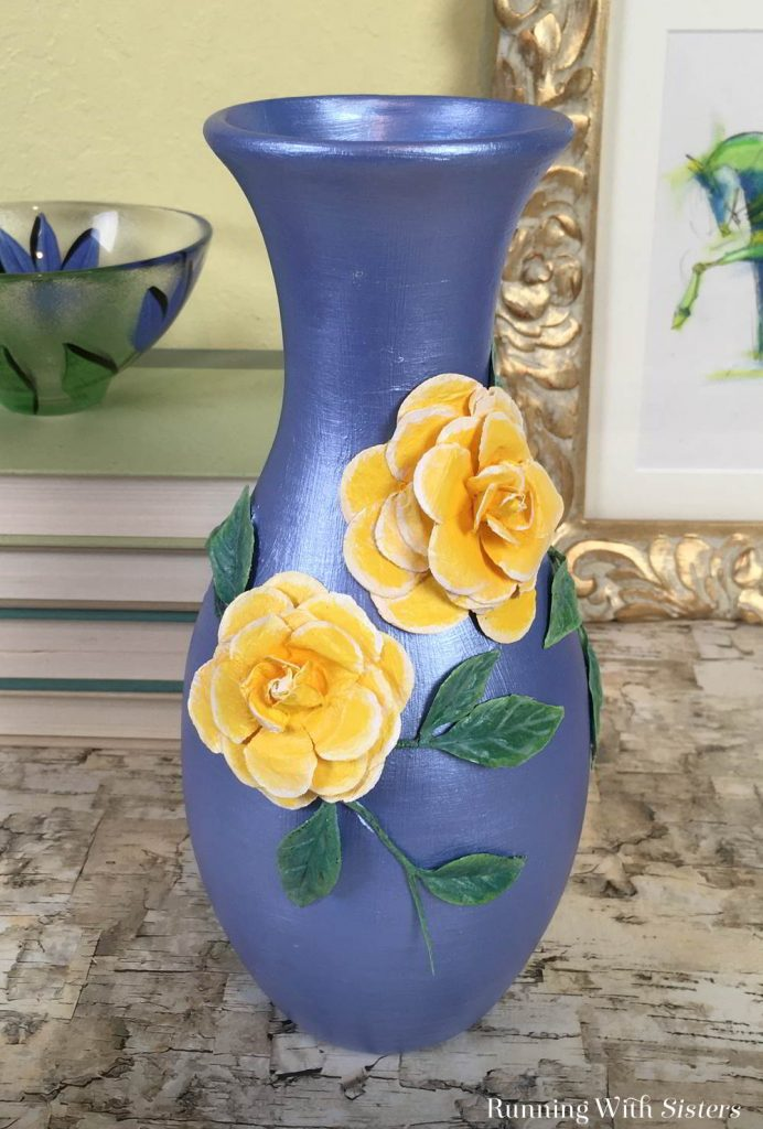 Turn a dollar store vase into a gorgeous home accent! We'll show you how to transform a vase with silk flowers and craft paint.