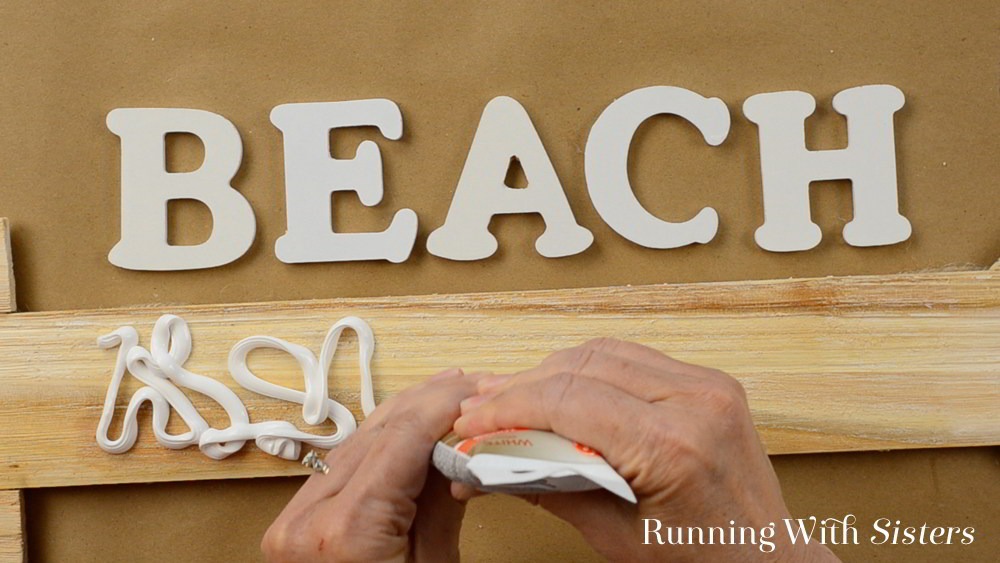 Make a mosaic sign using sea glass and wooden letters. In this video tutorial, we'll show you how to apply the adhesive, letters, and sea glass. Great mosaic project for beginners!