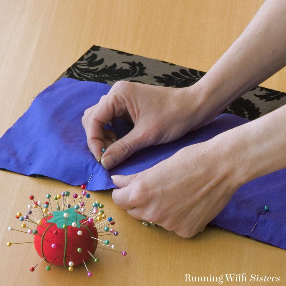 Learn to sew a throw pillow. We'll show you step by step how to pin the fabric, add embellishments, sew the seams, and stuff the throw pillow.