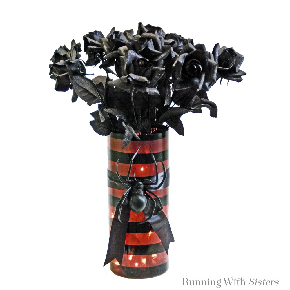 What are chic witches decorating their tables with this season? A bewitching bouquet of long-stemmed roses tipped in fine black glitter.
