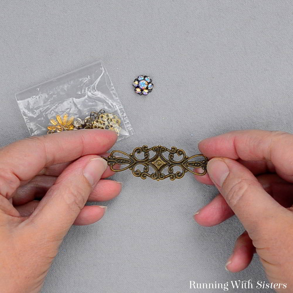 Make a Rosette Filigree Ring in just minutes! We'll show you how to turn a rhinestone rosette and filigrees into a DIY ring with vintage style.