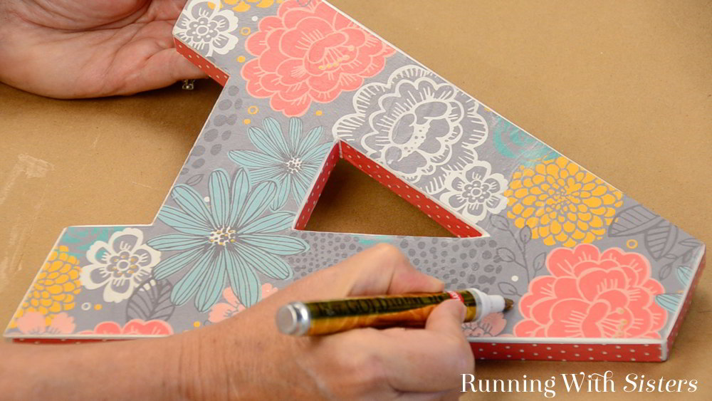 Decorate a wooden letter using Mod Podge. We''ll show you how to cut out the paper, how to decoupage the letter with Mod Podge, and how to finish the sides.
