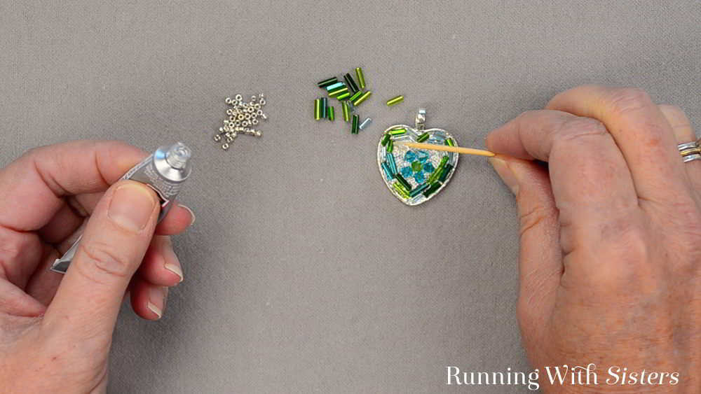 Bead Mosaic is really fun and easy! Basically we put glue into a frame called a bezel, then arrange beads inside to make a Mosaic Heart Pendant. We'll show you how!