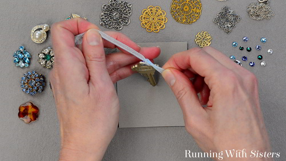 Get out your stash of broken jewelry and flea market trinkets to make a one-of-a-kind Glitzy Key Pendant! Great use for old keys and brooches!