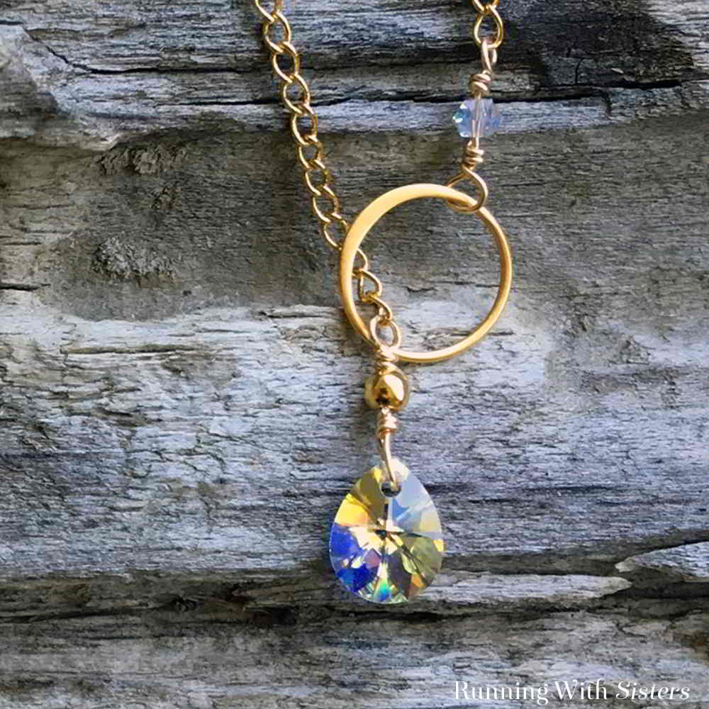 In this jewelry making video, we'll show you how to make wrapped loops to attach a crystal to chain to make a beautiful Crystal Lariat Necklace.