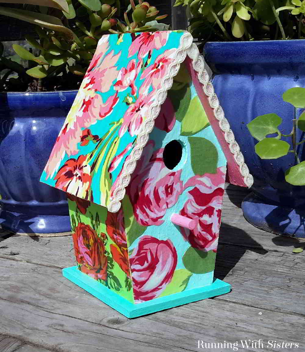 Make this pretty fabric covered birdhouse using gorgeous florals and ModPodge.
