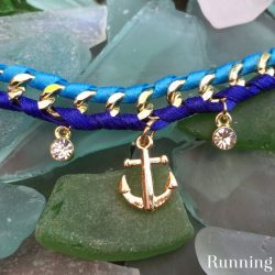 Make a Woven Chain Bracelet by lacing ribbon through chain and adding charms. Watch the video tutorial to see how to make your own.