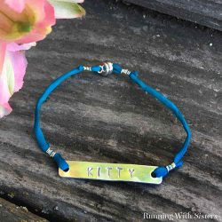 Make a personalized name bracelet by stamping metal. We'll show you how to make a stamped metal bracelet in this jewelry making video.