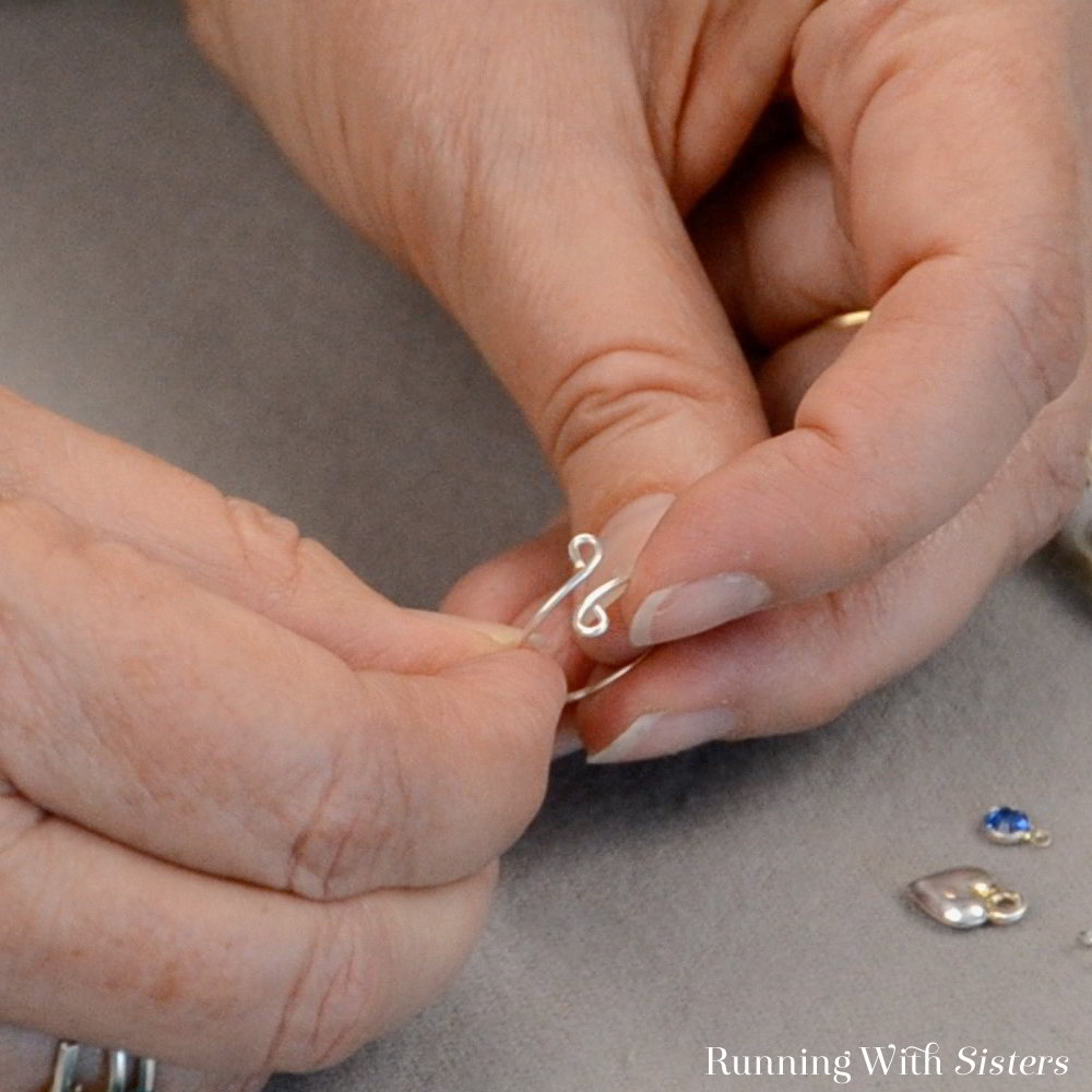 Learn to make a Delicate Charm Ring with this jewelry making video tutorial. All you need is wire and some charms! Fun as a friendship ring!