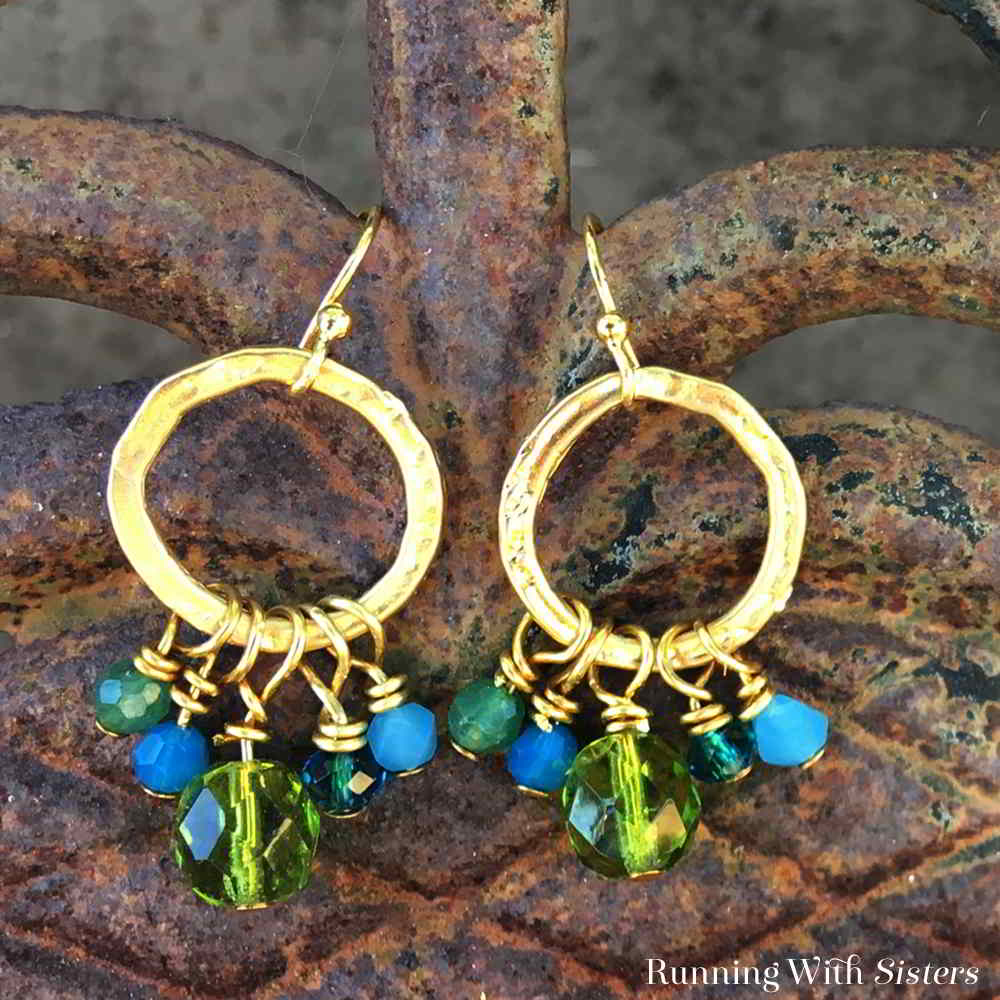 Make a pretty pair of crystal cluster earrings featuring green and blue crystals. We'll show you every step with this video tutorial.